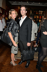 DAPHNE VASSILIADES and TIM HENCKENS at a party to celebrate the publication of Cartier's Panthere book at Maison Assouline, Picadilly, London on 7th September 2015