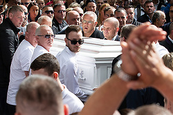 © Licensed to London News Pictures . Salford , UK . File picture of JOHN KINSELLA (centre, behind coffin with cropped grey hair and glasses) carrying Paul Massey's coffin at Paul Massey's funeral , in Salford , on 28th May 2015. Police have arrested several men in connection with the murders of both Kinsella and Massey. Photo credit : Joel Goodman/LNP