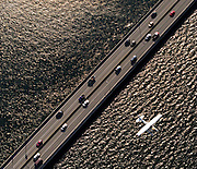 A helicopter ride provides an aerial view of the Evergreen Point Bridge as an airplane passes below. (Teresa Tamura, The Seattle Times)