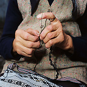 Maria Streulea, a Romanian peasant farmer, crochets the edge to a handwoven bag, the design typical to the Saxon Transylvania region, Saliste, Romania