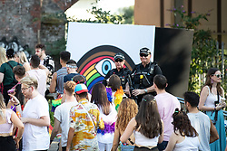 © Licensed to London News Pictures . 25/08/2019. Manchester, UK. Armed police patrol in and outside the venue as fans of Ariana Grande and other musical acts arrive at Mayfield Depot ahead of performances this evening . Manchester's annual Gay Pride festival , which is the largest of its type in Europe , celebrates LGBTQ+ life . Photo credit: Joel Goodman/LNP
