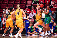 Missouri's Sophie Cunningham (3) trips as she is guarded by FGCU's Erica Nelson (11) and China Dow (22) during the second quarter of a first round NCAA tournament game at Maples Pavilion in Stanford, Calif., Saturday, March 17, 2018. (Joel Angel Juarez / Special to the Naples Daily News)