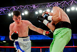 Ryan Wheeler of Bristol (silver shorts) on his way to a points victory over Janis Puksins (green shorts, black trim) in a Super Featherweight bout on the undercard - Photo mandatory by-line: Rogan Thomson/JMP - 07966 386802 - 13/06/2015 - SPORT - BOXING - Bristol, England - Action Indoor Sports Arena - Lee Haskins vs Ryosuke Iwasa - Interim IBF World Bantamweight Title Fight - UNDERCARD.