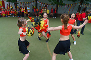 Children at a local school supporting the entrance of the Belgian Red Devils soccerteam. ghent, Belgium, 03.06.2016