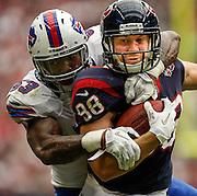 Nov 4, 2012; Houston, TX, USA; Buffalo Bills outside linebacker Nigel Bradham (53) tackles Houston Texans tight end Garrett Graham (88) during the second half at Reliant Stadium. The Texans won 21-9. Mandatory Credit: Thomas Campbell-US PRESSWIRE