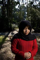 Stanford students, Atiqah Zailani (Muslim) among trees near Palm Drive.