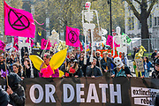 A funeral march, in Parliament Square, for all the dead, people, animals and insects as a result of climate change - Protestors from Extinction Rebellion block several (Hyde Park, Oxford Cuircus, Piccadilly Circus, Warterloo Bridge and Parliament Square) junctions in London as part of their ongoing protest to demand action by the UK Government on the 'climate chrisis'. The action is part of an international co-ordinated protest.