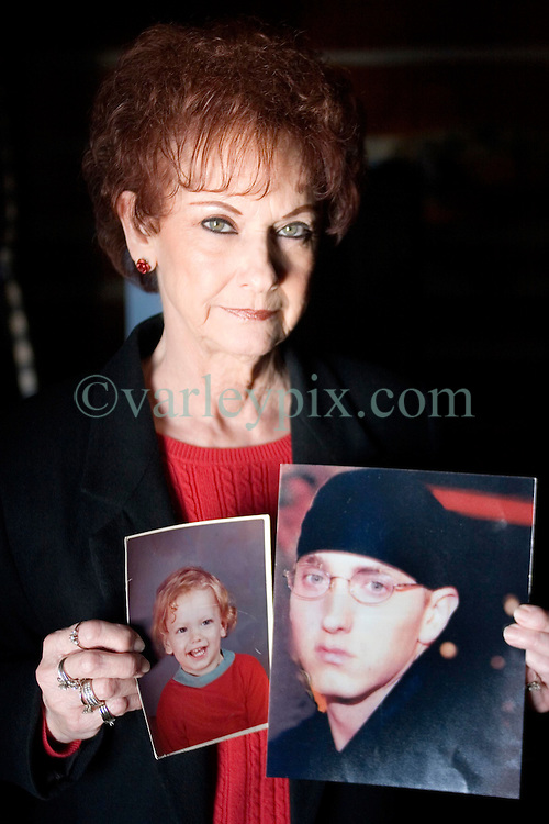 19 Jan, 2006. Remembering happier times. St Joseph, Kansas. Eminem's maternal grandmother Betty Kresin (64 yrs old) holds up a picture of her grandson when he was just 4 years old, the famous rapper Marshall Bruce Masthers III, aka Eminem. Betty is sad and disappointed that she and her family in Kansas, including Eminem's mother Debbie Nelson were not invited to his recent re-marriage to Kim.<br /> Photo; Charlie Varley/varleypix.com