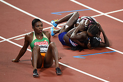 Murielle Ahouré of the Ivory Coast watches the big screen as Tori Bowie of the USA celebrates gold with a fellow athlete - Mandatory byline: Patrick Khachfe/JMP - 07966 386802 - 06/08/2017 - ATHLETICS - London Stadium - London, England - Women's 100m Final - IAAF World Championships
