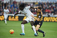 Bafetimbi Gomis of Swansea city holds off Laurent Koscielny of Arsenal. Barclays Premier league match, Swansea city v Arsenal  at the Liberty Stadium in Swansea, South Wales  on Saturday 31st October 2015.<br /> pic by  Andrew Orchard, Andrew Orchard sports photography.