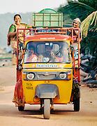 Tuk tuk carrying passengers on beach in Trivandrum, Kerala, India