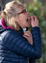 © Licensed to London News Pictures. 02/02/2021. London, UK. A woman self administering a test at a new Variant Testing Centre in Ealing, West London, set up after the discovery of a new South African variant of coronavirus. Door-to-door delivery of free home test kits is to start in the area in an attempt to slow the spread of the more aggressive strain of the virus. Photo credit: Ben Cawthra/LNP