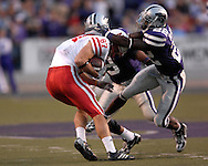 Kansas State defensive back Justin McKinney (22) tackles Nebraska wide receiver Nate Swift (87) after making a catch in the first half at Bill Snyder Family Stadium in Manhattan, Kansas, October 14, 2006.  The Huskers beat the Wildcats 21-3.<br />