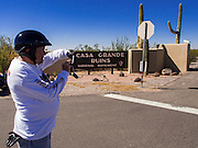 01 OCTOBER 2013 - CASA GRANDE, AZ: A man takes a picture of the gate to the Casa Grande Ruins in Casa Grande, AZ. The ruins are a US national monument and were closed Tuesday because of the partial shutdown of the US government. All national monuments and national parks were closed Tuesday. The US government closed most non-essential federal services Tuesday. The shutdown is be the first in the US in 17 years. More than 700,000 federal government workers could be sent home on unpaid leave, with no guarantee of back pay once the deadlock is over.    PHOTO BY JACK KURTZ