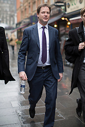 © licensed to London News Pictures. London, UK 07/03/2013. Deputy Prime Minister, Nick Clegg leaving LBC Radio Studio in Leicester Square, London on Thursday, 07 March 2013 after his Call Clegg radio programme ahead of the Spring Conference. Photo credit: Tolga Akmen/LNP