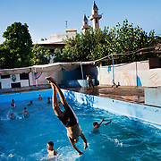 The pool in Ein El-Hilweh refugee camp, home to 75.000 Palestinians.  Developmental Action Without Borders(Naba'a) work in Palestinian refugee camps across Lebanon to help children in the camps.  The camps are densely over-crowded and many of the children are 4th generation refugees living in Lebanon with no citizenship or rights and under immense pressure.