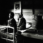 Women sit in the bed inside the special ward for victims of sexual violence at Gesom Hospital in Goma.