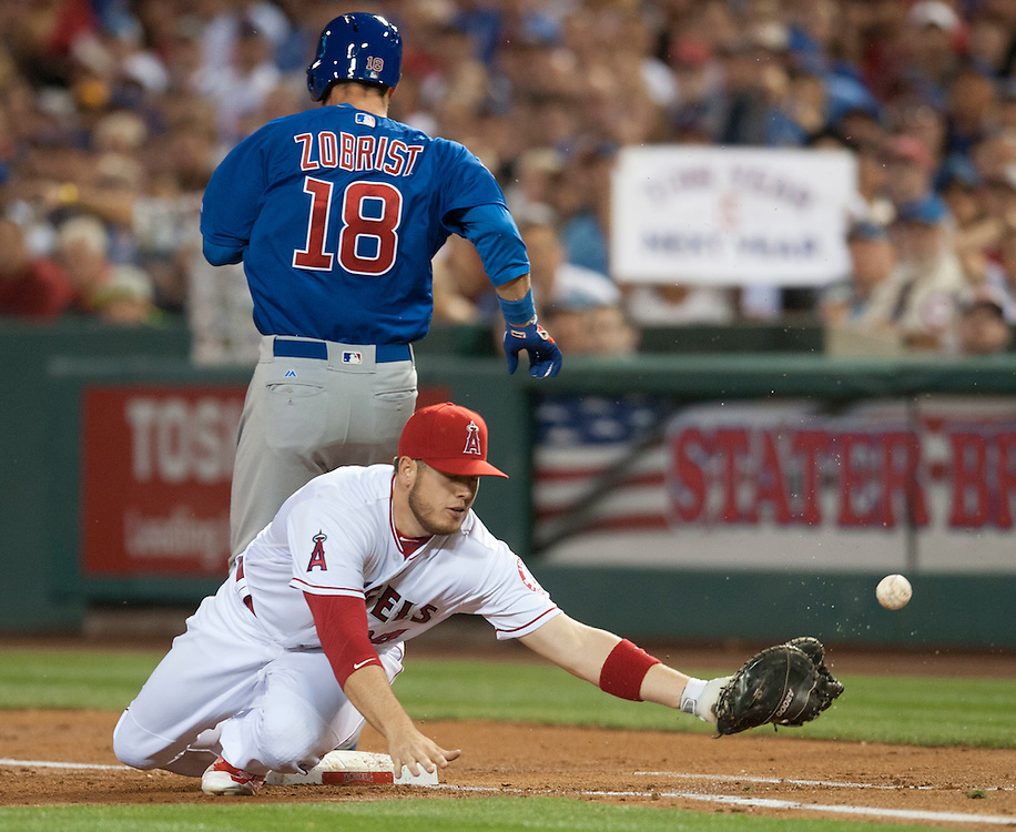 Angels first baseman C.J. Cron can't handle the throw from starting pitcher Andrew Heaney as the Cubs' Ben Zobrist is safe at first during their game at Angel Stadium Tuesday.<br /> <br /> ///ADDITIONAL INFO:   <br /> <br /> angels.0406.kjs  ---  Photo by KEVIN SULLIVAN / Orange County Register  --  4/5/16<br /> <br /> The Los Angeles Angels take on the Chicago Cubs Tuesday at Angel Stadium.<br /> <br /> <br />  4/5/16
