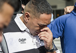 March 16, 2019 - Christchurch, Canterbury, New Zealand - Mahe Haniisi of Christchurh Boys High School is overcome during an impromptu song and prayer service on the street near the Al Noor mosque, where 41 people were killed. (Credit Image: © PJ Heller/ZUMA Wire)