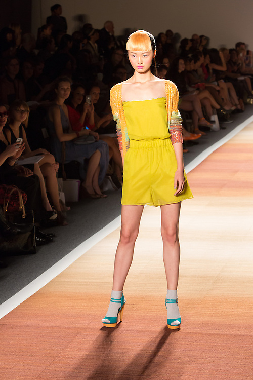 Chartreuse shorts with matching sleveeless top and a sweater  in graduated pastels.