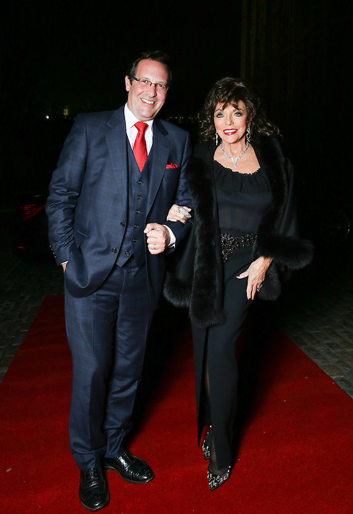 Joan Collins & guest attend an evening of fundraising at the Tower of London on Monday 2 November 2015, in aid of The Children's Trust. <br /> Nick and Holly Candy were joined by a host of stars and supporters at the Tower of London on Monday night, for a spectacular evening of fundraising in aid of The Children's Trust. <br /> Photos Ki Price