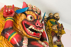 Close-up of wooden sculptures of Bhairav on wall, Nepal