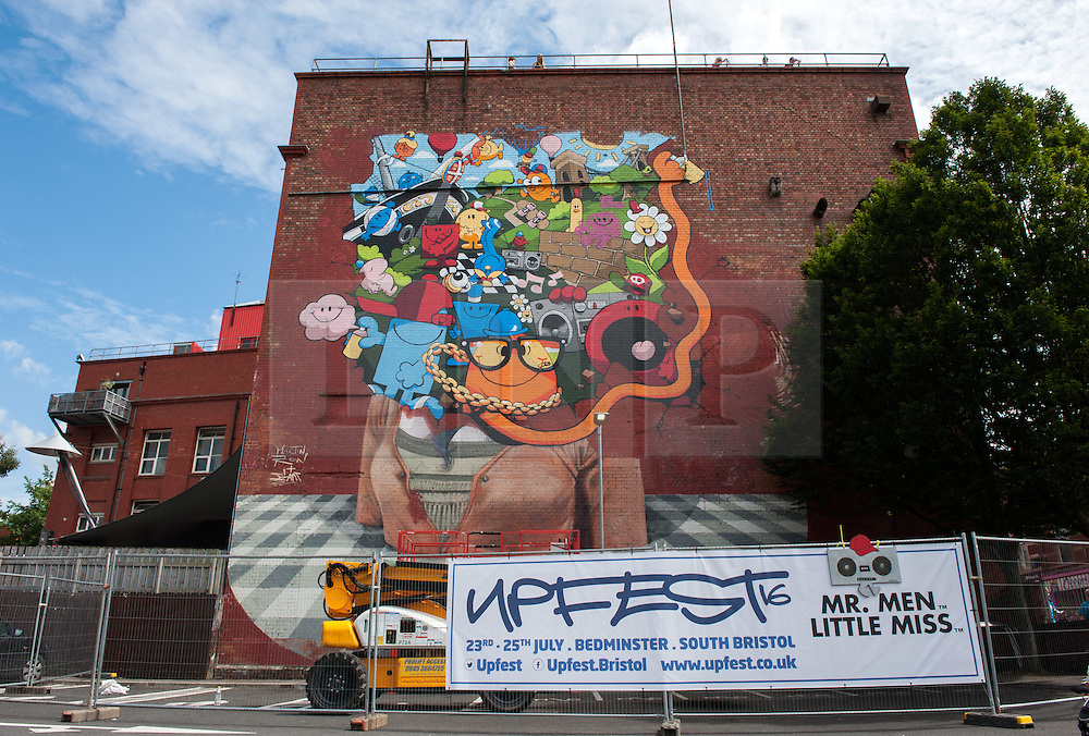 © Licensed to London News Pictures.23/07/2016. Bristol, UK.  Giant piece on the theme of Mr Men on the side of the Tobacco Factory at Upfest street art festival 2016, Europe's largest, free, street art & graffiti festival, attracting over 300 artists painting 28 venues throughout Bedminster & Southville, Bristol.  Photo credit : Simon Chapman/LNP