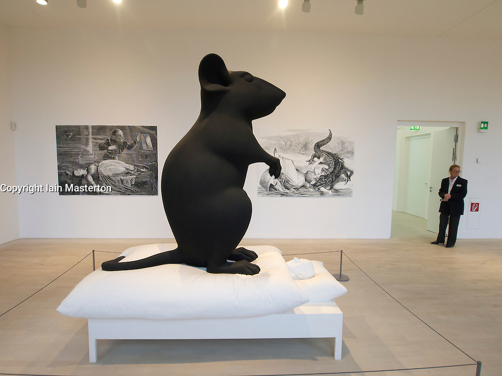 Modern art sculpture Man and Mouse by Katharina Fritsch at K21 Kunstsammlung art museum in Dusseldorf in Germany