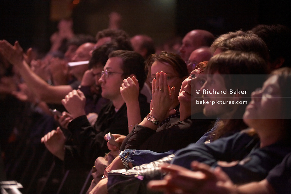 French and British front-row audience fans of rock band Status Quo listen during European tour gig at L'Aeronef in Lille, France