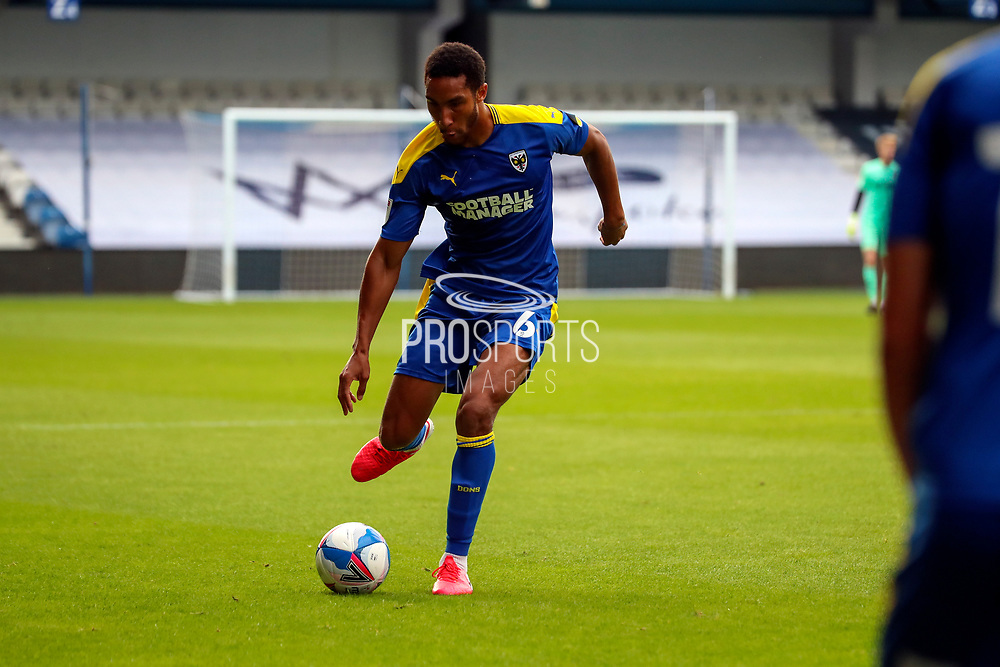 AFC Wimbledon defender Terell Thomas (6) passing the ball during the EFL Trophy Group O match between AFC Wimbledon and Charlton Athletic at the Kiyan Prince Foundation Stadium, London, England on 1 September 2020.