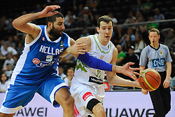 Ioannis Bourousis of Greece vs Goran Dragic of Slovenia during friendly match between National Teams of Slovenia and Greece before World Championship Spain 2014 on August 17, 2014 in Kaunas, Lithuania. Photo by Robertas Dackus / Sportida.com