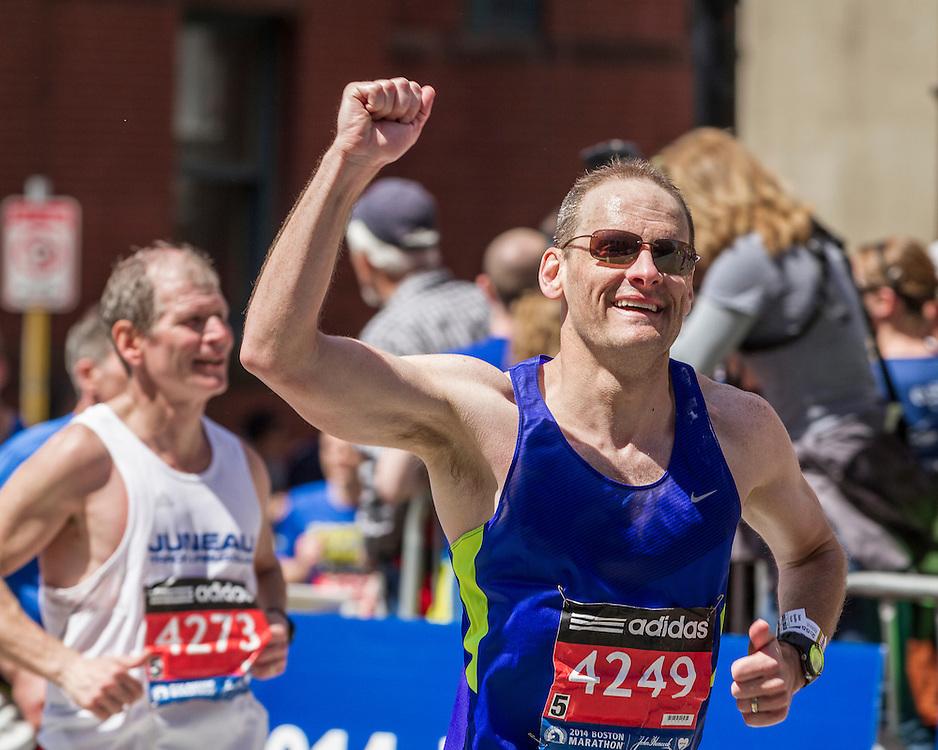 2014 Boston Marathon: triumphant runner heading for the finish line