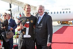 15.07.2014, Flughafen, München, GER, FIFA WM, Empfang der Weltmeister in Deutschland, Finale, im Bild l-r: Manuel Neuer #1 (Deutschland) und Horst Seehofer (Ministerpraesident) // during Celebration of Team Germany for Champion of the FIFA Worldcup Brazil 2014 at the Flughafen in München, Germany on 2014/07/15. EXPA Pictures © 2014, PhotoCredit: EXPA/ Eibner-Pressefoto/ Christian Kolbert<br /> <br /> *****ATTENTION - OUT of GER*****