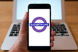 New Elizabeth Line logo on website on smart phone screen.