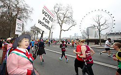 Members of the Suffragist Pageant encourage runners along the Embankment during the 2018 London Landmarks Half Marathon. PRESS ASSOCIATION Photo. Picture date: Sunday March 25, 2018. Photo credit should read: John Walton/PA Wire