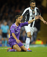 Football - 2017 UEFA Champions League Final - Juventus vs. Real Madrid<br /> <br /> Christiano Ronaldo of Real Madrid complains after being fouled, at the Principality [Millennium] Stadium.<br /> <br /> COLORSPORT/ANDREW COWIE