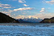 Mount Breakenridge behind a frozen Harrison Lake shoreline.  Photographed from Harrison Hot Springs, British Columbia, Canada