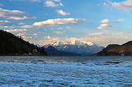 Mount Breakenridge behind a frozen Harrison Lake shoreline.  Photographed from Harrison Hot Springs, British Columbia, Canada