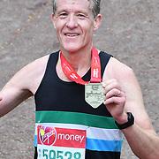 London, England, UK. 28 April 2019. Chris Finill finish the Virgin Money London Marathon at Pall Mall.