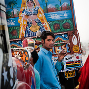A truck in Jaipur features a depiction of an Indian woman carrying water.