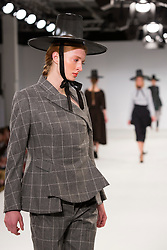 © Licensed to London News Pictures. 30/05/2015. London, UK. A model walks the runway during the UCA Rochester fashion show at Graduate Fashion Week 2015 wearing the collection of graduate student Jihae An. Graduate Fashion Week takes place from 30 May to 2 June 2015 at the Old Truman Brewery, Brick Lane. Photo credit : Bettina Strenske/LNP