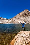 Hiker celebrating at Cottonwood Lake #5, John Muir Wilderness, California USA