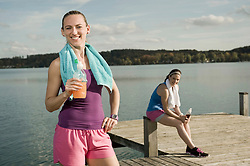 Jogging women taking a break, Woerthsee, Bavaria, Germany