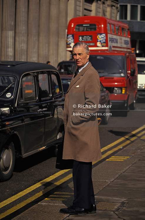 An elderly and smartley-dressed City of London gentleman stands at the kerbside outside the Bank of England on Threadneedle Street, on 16th June 1994, in London, England.