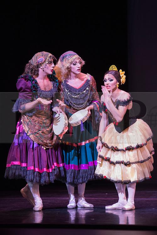 © Licensed to London News Pictures. 18/09/2015. London, UK. Varvara Bractchikova (Giovanni Goffredo) and Eugenia Repelskii (Joshua Thake) as Gypsies with Yakaterina Verbosovich (Chase Johnsey) as Kitri. Les Ballets Trockadero de Monte Carlo (The Trocks) perform the UK premiere of Don Quixote during a photocall at the Peacock Theatre. With Yakaterina Verbosovich (Chase Johnsey) as Kitri, PVyacheslav Legupski (Paolo Cervellera) as Basil, Olga Supphozova (Robert Carter) as Amour, Lariska Dumbcheno (Raffaele Morra) as Mother, Boris Nowitsky (Carlos Renedo) as Count and Varvara Bractchikova (Giovanni Goffredo) and Eugenia Repelskii (Joshua Thake) as Gypsies. Photo credit: Bettina Strenske/LNP