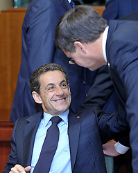 """Nicolas Sarkozy, France's president, left, speaks with Jan Peter Balkenende, the Netherlands's prime minister, during the European Union Summit at the EU headquarters in Brussels, Belgium, on Thursday, Oct. 29, 2009. European Union leaders are set for """"very difficult"""" talks to overcome the Czech Republic's resistance to a new governing treaty designed to strengthen the EU's influence in world affairs, Reinfeldt said. (Photo © Jock Fistick)"""