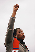 Bianca Davis-Lovelace, of United Church of Christ, raises her fist as several thousand demonstrators gathered outside the Federal Detention Center in SeaTac to protest the separation of families crossing the southern border and the Trump administration's immigration policies as part of a nationwide Families Belong Together day of action, June 30, 2018.
