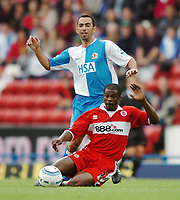 Photo: Back Page Images. 16/10/2004.<br /> Barclays Premiership. Blackburn Rovers v Middlesbrough. Ewood Park.<br /> <br /> Youri Djorkaeff is disposesed by George Boateng
