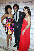 l to r: D.Woods, Jermaine Brown and Mya at The Junior Smile Couture Event 2009 Benefiting Operation Smile In Association with the C.E.M Group held at Captiale on April 23, 2009 in New York City.