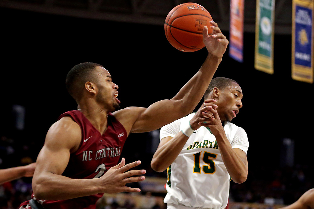 Mar 16, 2019; Norfolk, VA, USA; North Carolina Central Eagles forward Jibri Blount (2) knocks the ball away from Norfolk State Spartans guard C.J. Kelly (15) during the first half in the MEAC Tournament Final at The Scope. Mandatory Credit: Peter Casey-USA TODAY Sports